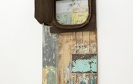 <p>Friendly Fire (view 2)</p> <p>wood, acrylic, collage, metal, crayons</p> <p>2012</p> <p>63.5 x 26 x 4</p>
