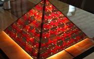 """<p style=""""text-align: center;""""><strong>Light Pyramid / On<br /></strong></p> <p style=""""text-align: center;"""">wood, resin, electric light</p> <p style=""""text-align: center;"""">21 x 21 x 14</p>"""