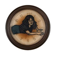 "<p><em>The Hours 7</em>, 2009, 9""diam. Ink, acrylic and polyurethane in clock. </p>"