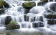 <p>Moss covered rocky waterfall.</p>