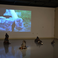 <p><em><strong>The rock where an outlaw dreads the dark</strong></em>, 2015. Video loop projection, plaster, hydrocal, iron oxide, ink, graphite, PVA, polystyrene.</p>