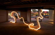 <p><em>Drain</em>&nbsp;|&nbsp;PVC pipe, zip ties, lights | dimension may vary | 2012</p>