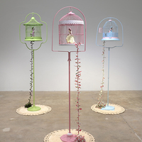 <p>Genevieve Gaignard<br /><em>The Great Escape / Migration, 2019&nbsp;</em><br />Vintage birdcage, custom porcelain figurine, fabric<br />65 x 14 inches each</p>
